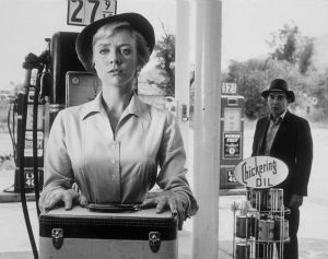 "Inger Stevens, as driver Nan Adams, and Leonard Strong, as the titular hitchhiker, in a still from ""The Twilight Zone"" episode based on ""The Hitch-Hiker"" (courtesy Wikimedia Commons)"